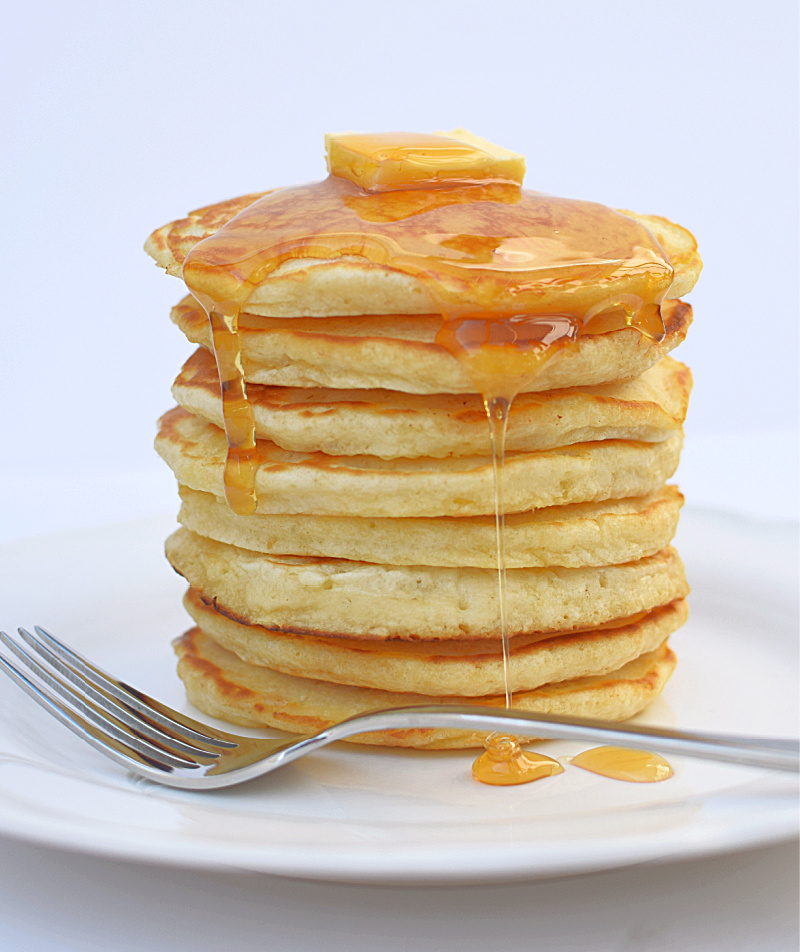 Gluten free pancake stack on a white plate
