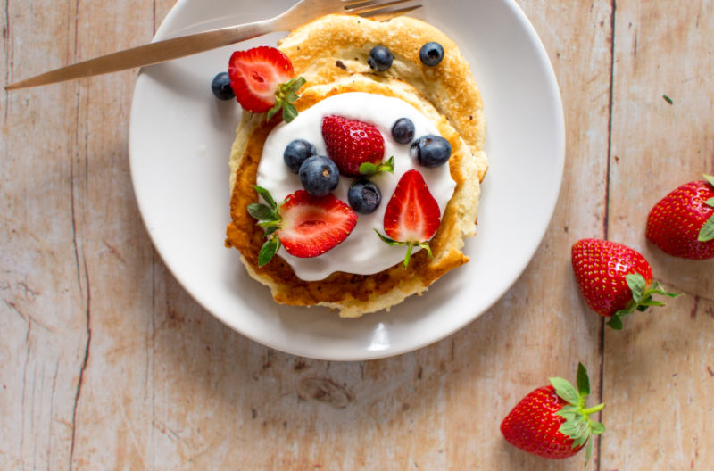 Banana pancakes with fruit and yoghurt